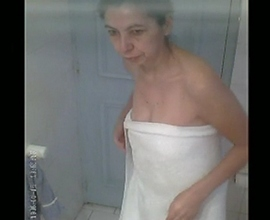 Mature Indian milf filmed naked in shower