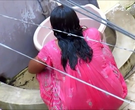 Indian aunty taking shower in open